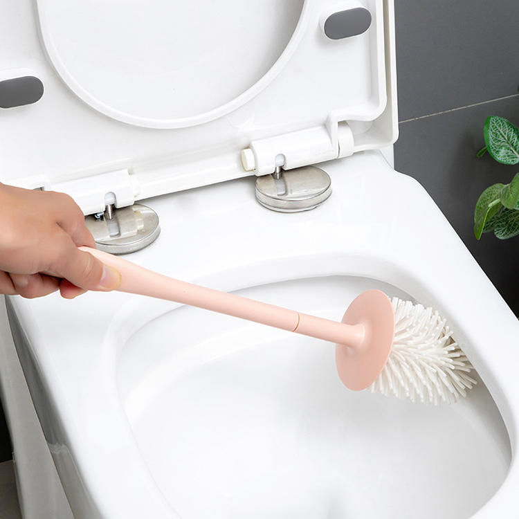 Folding toilet cleaning brush uses in bathroom with three colors